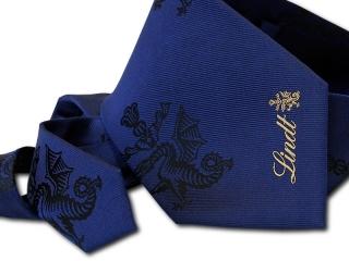 a tie with a logo: MIESZKO